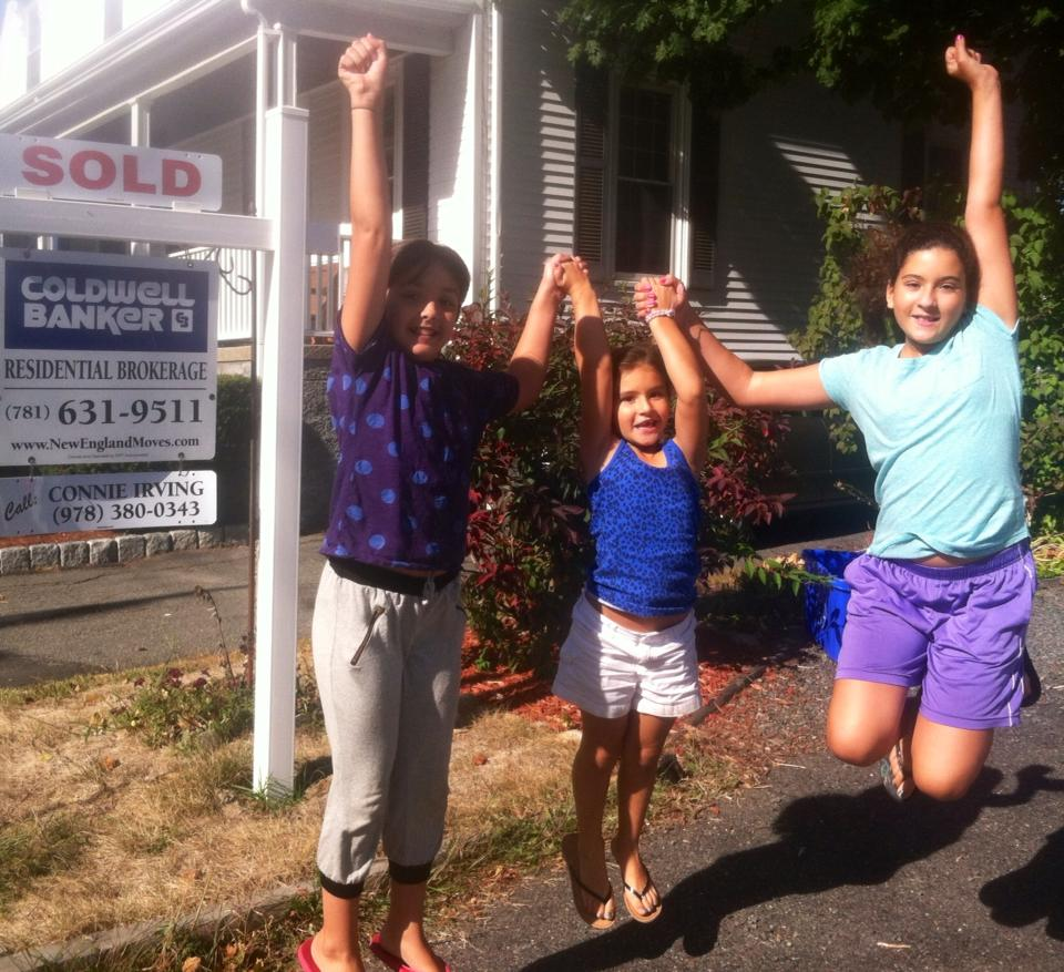 pics of kids in front of sold sign